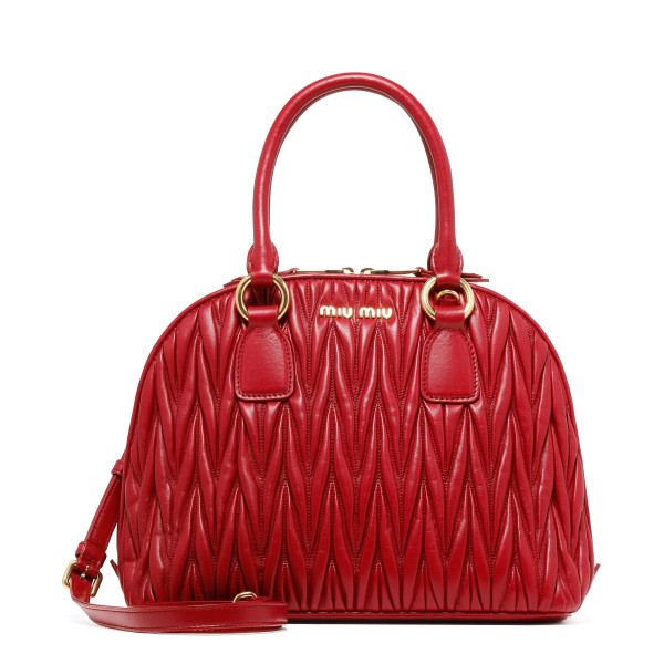 Red matelassé leather handbag