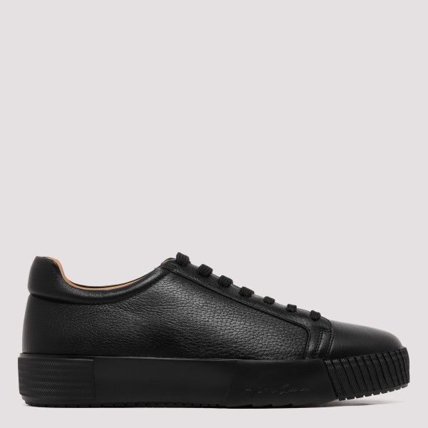 Black sneakers with logo on...
