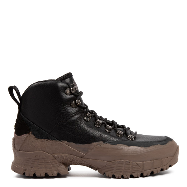 Black and mud hiking boots