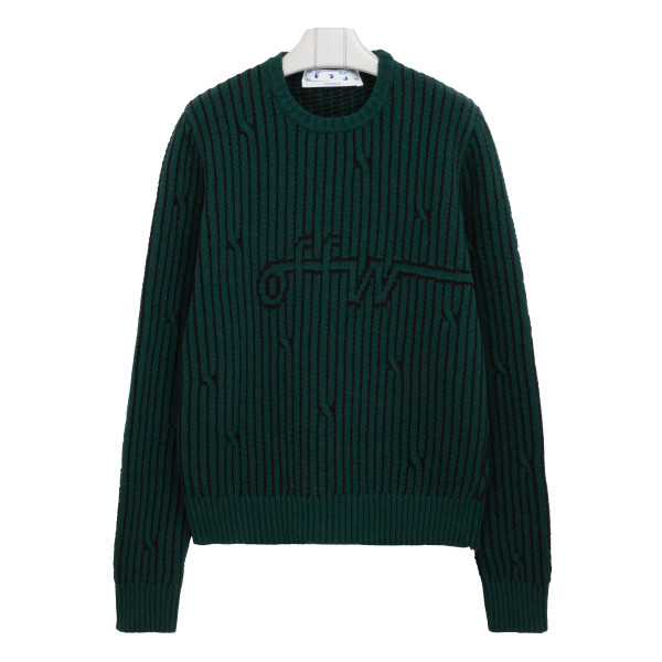 Black and green cable-knit sweater