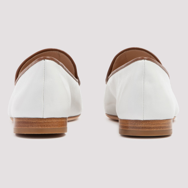 White and brown leather loafers