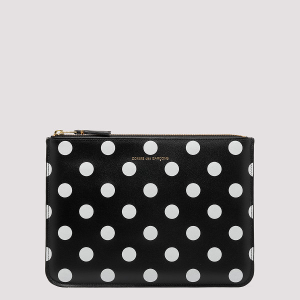 Black polka dots printed...